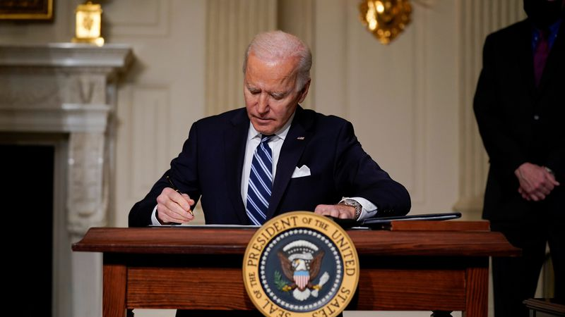 President Joe Biden signs an executive order on climate change, in the State Dining Room of the...