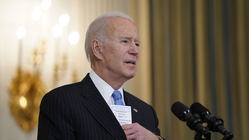 President Joe Biden speaks about efforts to combat COVID-19, in the State Dining Room of the...