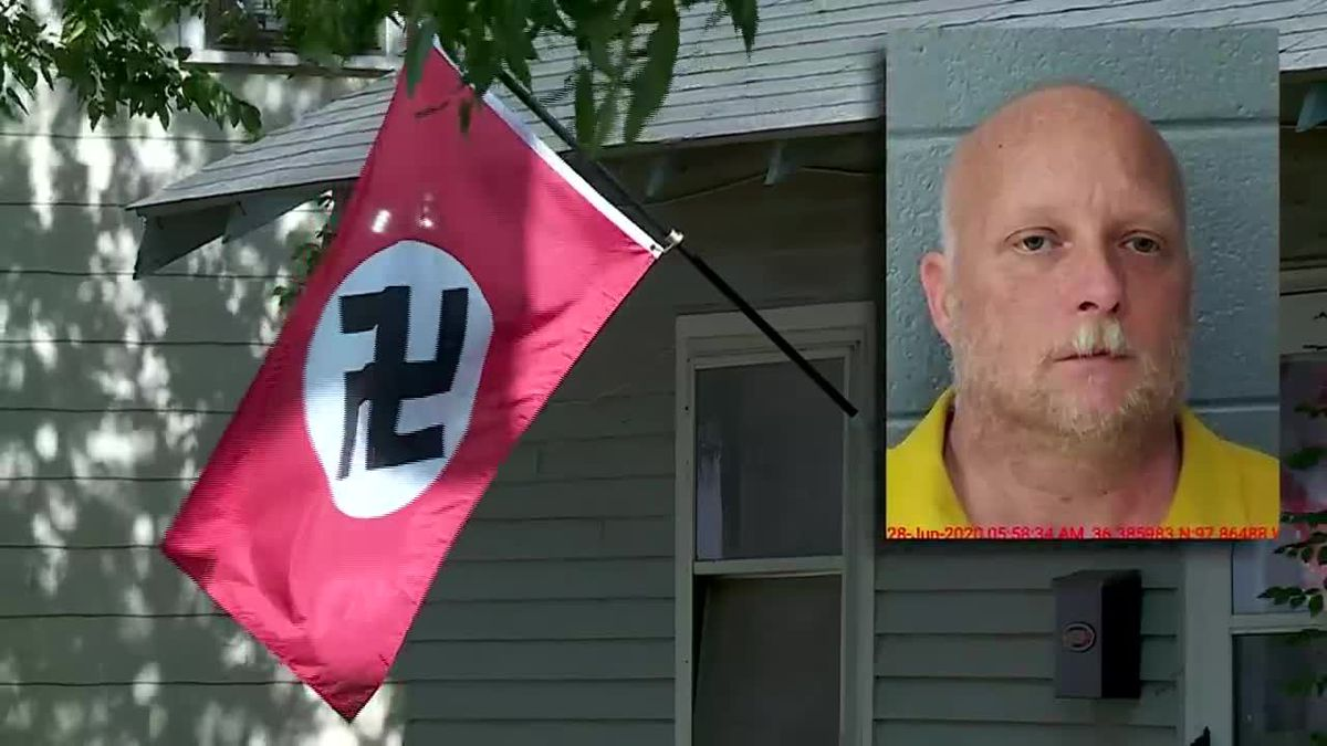 An Oklahoma man is accused of shooting a woman who tried to steal his Nazi flag.