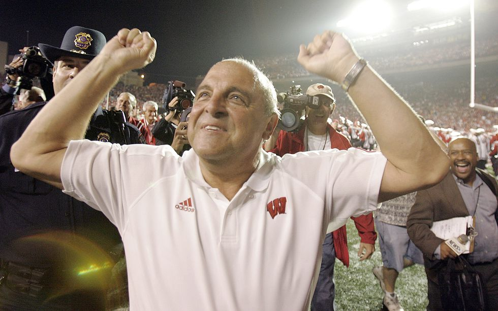 Wisconsin coach Barry Alvarez celebrates walking off the field after Wisconsin beat Michigan,...