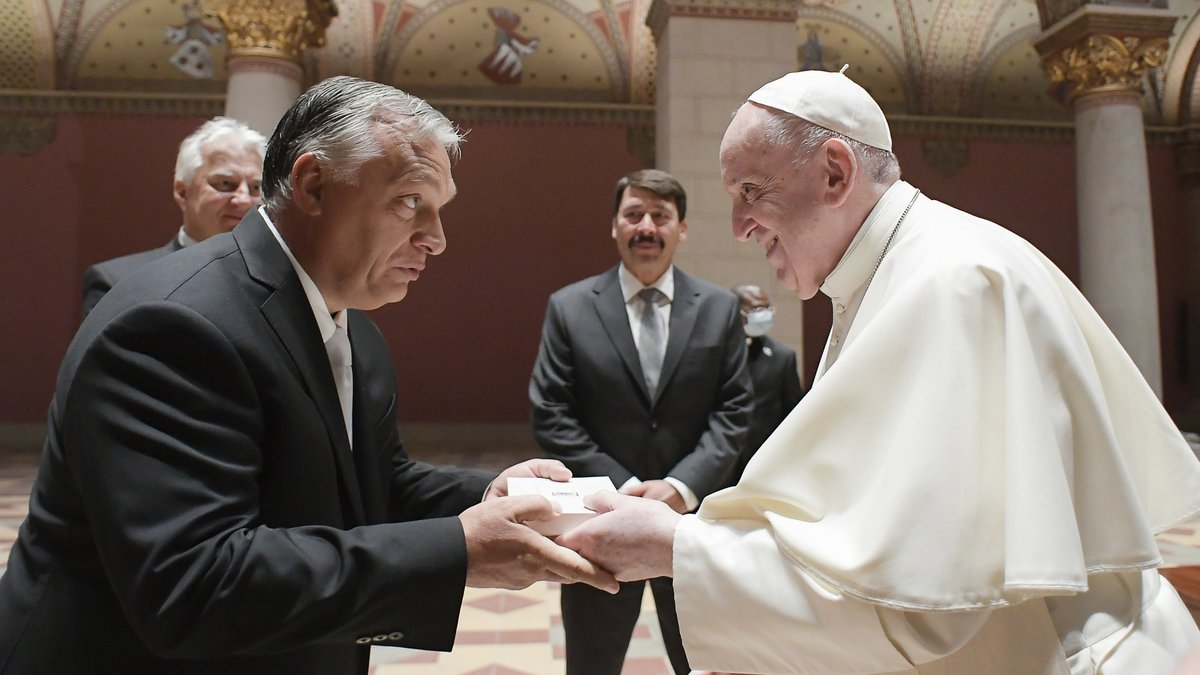 Pope Francis exchanges gifts with Hungarian Prime Minister Viktor Orban, at Budapest's Museum...
