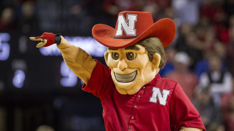 Nebraska's mascot Herbie Husker is on the court entertaining the fans in a time out in the game...
