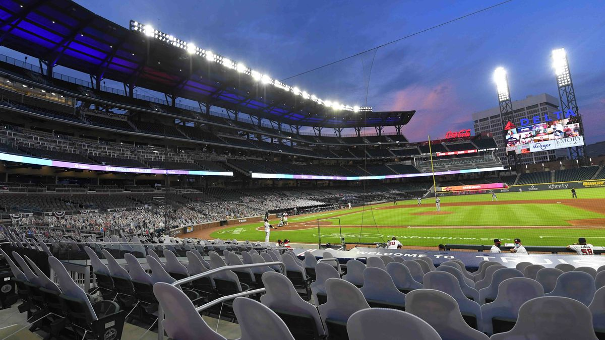 FILE - This photo from Thursday July 30, 2020, shows cardboard cutouts of fans in seats during...