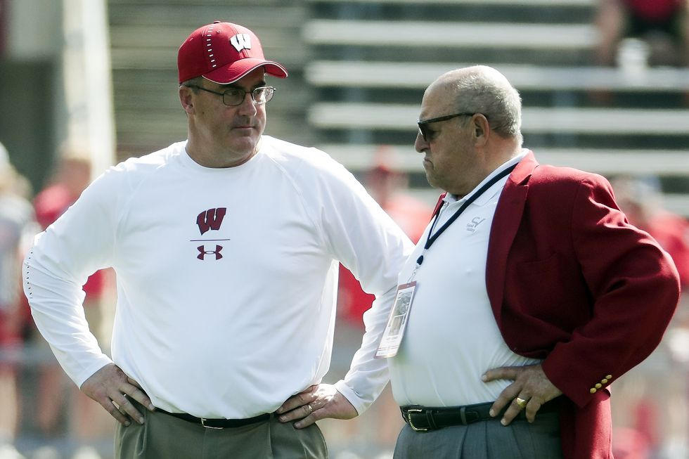 FILE - In this Sept. 15, 2018, file photo, Wisconsin head coach Paul Chryst, left, talks to...