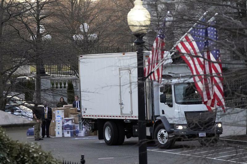 A van arrives to pick up boxes that were moved out of the Eisenhower Executive Office building,...