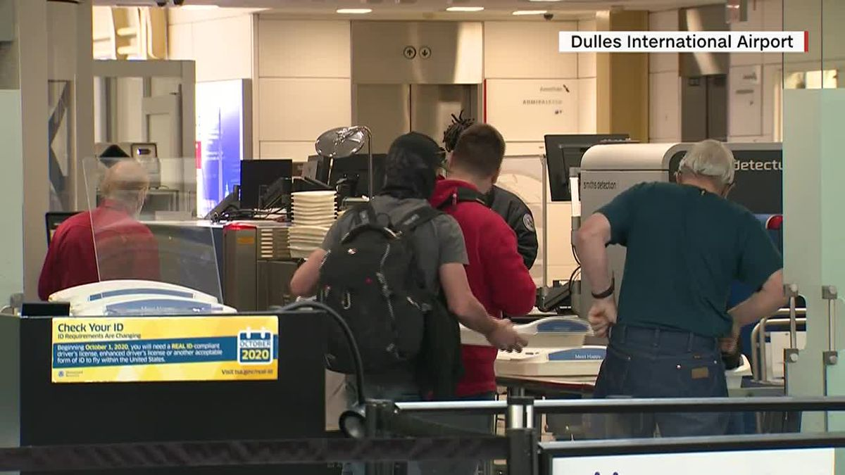 Travelers go through security at the Dulles International Airport. With summer in full swing, air travel is rebounding despite the pandemic. (Source: CNN)