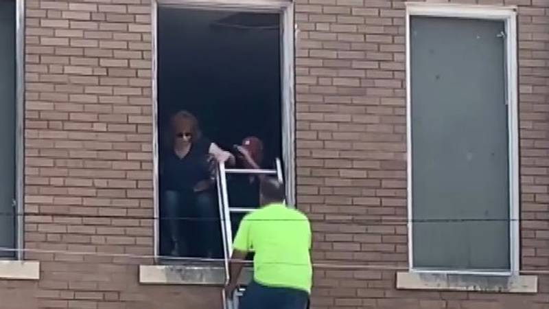 Reba McEntire was rescued from a second-story building window in downtown Atoka after the...
